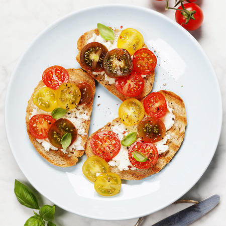toasted sandwich: Tomato and basil sandwiches with ingredients - Italian, Vegetarian or Healthy food concept Stock Photo