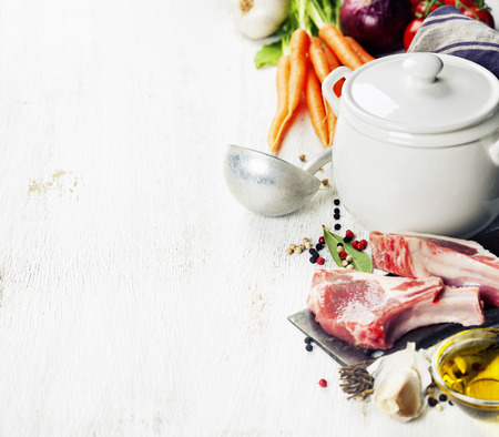Raw vegetables and meat set with herbs and spices, ingredient for broth or soup, food background