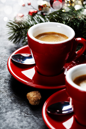 christmas scent: Coffee Espresso. Red Cups Of Coffee and Christmas decorations on dark background