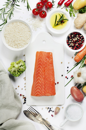 fresh fish: Delicious portion of fresh salmon fillet with aromatic herbs, spices and vegetables - healthy food, diet or cooking concept. Top view.