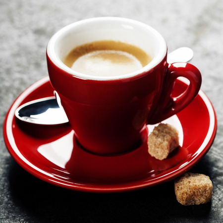espresso cup: Coffee Espresso. Red Cup Of Coffee on dark background Stock Photo