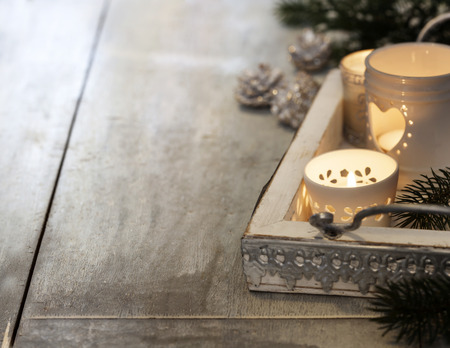 christmas candles: Christmas candles on wooden background. Christmas background