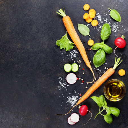 fresh food: Fresh organic vegetables on dark rustic background. Healthy food. Vegetarian eating. Fresh harvest from the garden. Background layout with free text space.