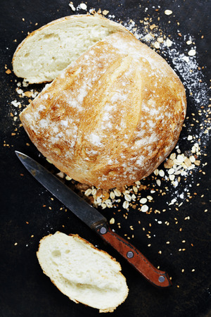 natural  moody: Homemade bread loaf on rustic dark background