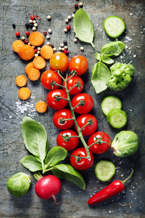 Fresh organic vegetables on rustic background. Healthy food. Vegetarian eating. Fresh harvest from the garden.