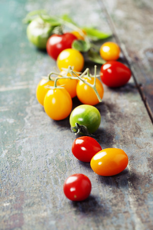 heirloom: various of colorful tomatoes on wooden background. Cooking, Healthy Eating or Vegetarian concept