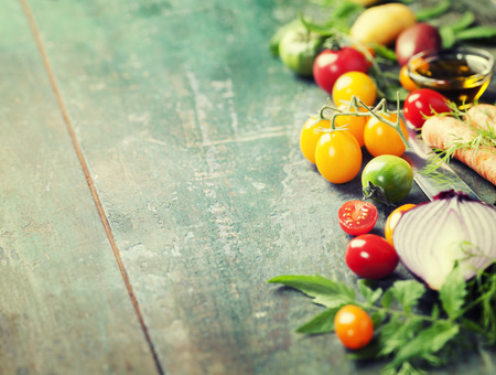 Vegetables on wood. Bio Healthy food, herbs and spices. Organic vegetables on wood. Cooking, Healthy Eating or Vegetarian concept.  Background layout with free text space. Stockfoto