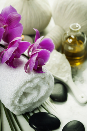 scincare: Spa background (white orchid, herbal compress stamps, sea salt, towel and massage stones)