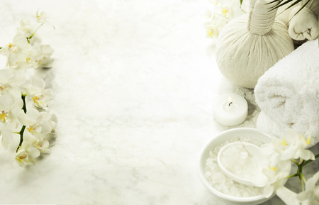 Spa background (white orchid, herbal compress stamps, sea salt, towel and massage stones) Zdjęcie Seryjne - 48596171