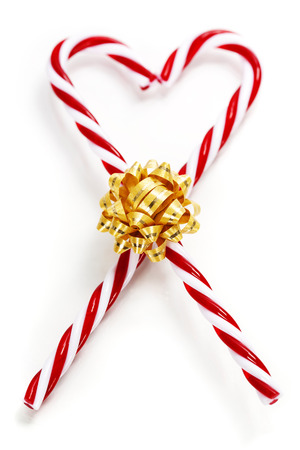lolli: Two Candy Canes in Heart Shape over white