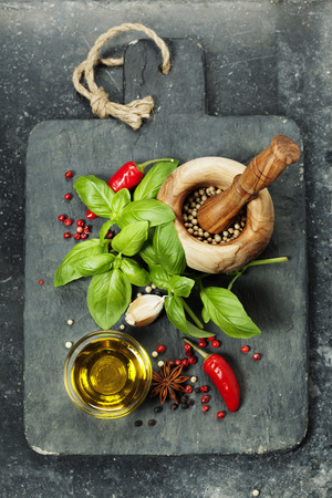 cooking oil: vintage cutting board and fresh ingredients - Cooking, Healthy Eating or Vegetarian concept Stock Photo