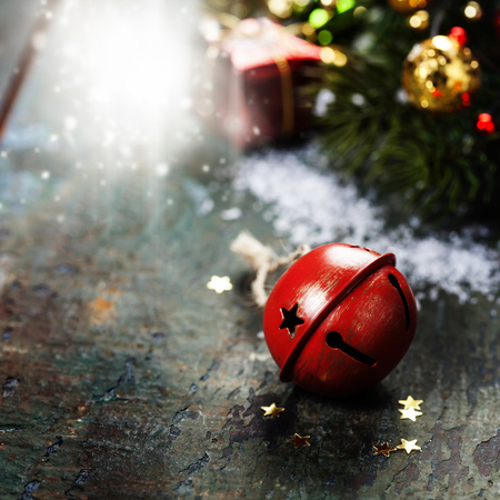 jingling: Christmas Jingle bells  on a rustic wooden background