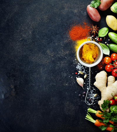 Fresh  ingredients on dark background. Vegetarian food, health or cooking concept. Background layout with free text space. Stockfoto