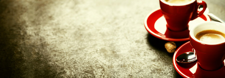 espresso: Coffee Espresso. Red Cups Of Coffee on dark background
