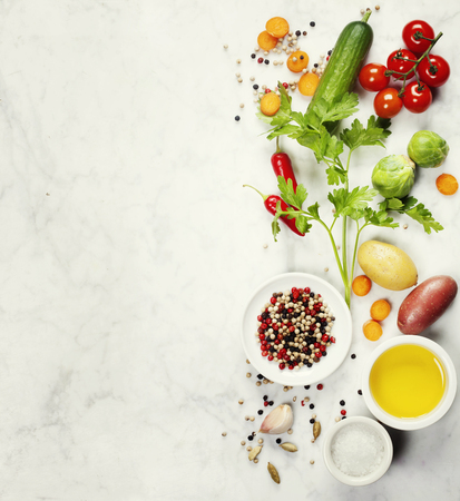 Various colorful spices and vegetables on marble table. Bio Healthy food, herbs and spices. Organic vegetables. Vegetarian food. Background layout with free text space.