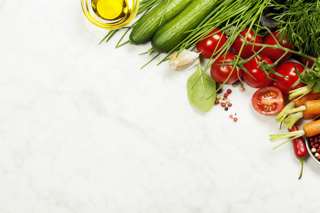 vegetables on white: fresh organic garden vegetables on white rustic stone background, healthy cooking concept Stock Photo