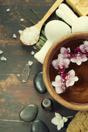 spa flower: Close up of flowers floating in bowl of water and SPA setting Stock Photo