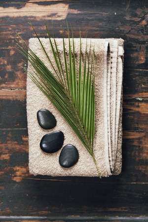 scincare: Spa background (towel, massage stones and leaf )