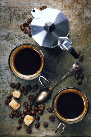 Coffee and Espresso maker on vintage background