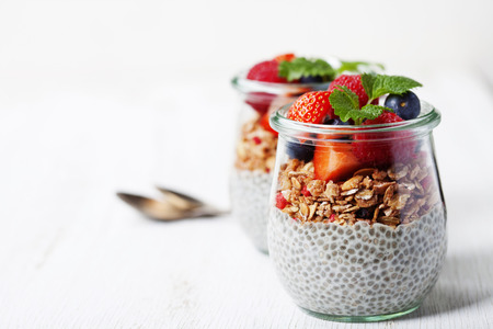 ?hia seeds vanilla pudding and berries on wooden rustic background - Healthy food, Diet, Detox, Clean Eating or Vegetarian concept. Background layout with free text space.
