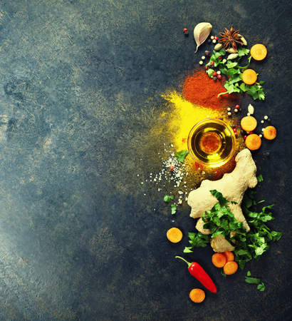 kitchen tools: Fresh  ingredients on dark background. Vegetarian food, health or cooking concept. Background layout with free text space. Stock Photo