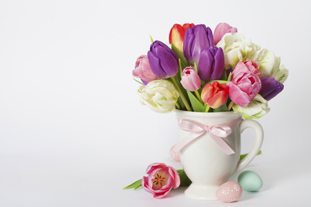 womans: Beautiful tulips bouquet and easter eggs  - spring, easter or gardening concept Stock Photo