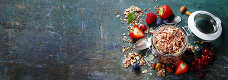 diet concept: Healthy breakfast of muesli, berries with yogurt and seeds on dark background -  Healthy food, Diet, Detox, Clean Eating or Vegetarian concept.