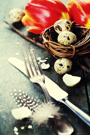 background settings: Easter table settings with fresh tulips on vintage wooden background