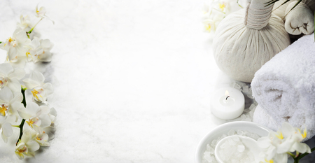 white towel: Spa background (white orchid, herbal compress stamps, sea salt, towel and massage stones)