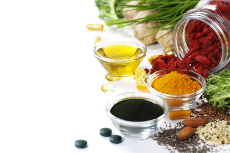 nutritional supplement: Dietary supplements. Spirulina, turmeric and organic oil on white background.