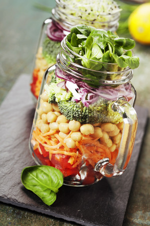 chickpea: Healthy Homemade Mason Jar Salad with Chickpea and Veggies - Healthy food, Diet, Detox, Clean Eating or Vegetarian concept Stock Photo