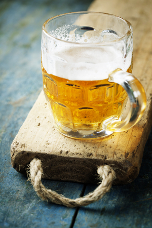 unbottled: beer on wood background with copyspace Stock Photo