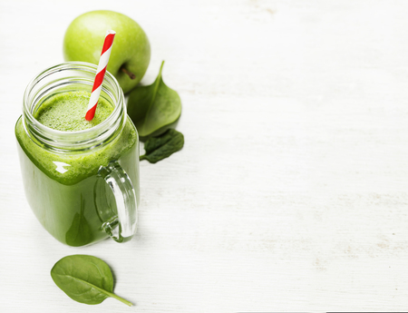 Healthy green smoothie and ingredients on white  - superfoods, detox, diet, health, vegetarian food concept Stock Photo