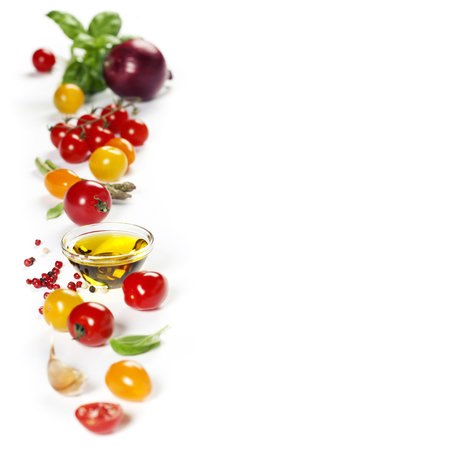 vegetables on white: colorful tomatoes and vegetables over white background - Healthy eating, vegetarian or cooking concept Stock Photo
