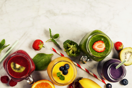 marble background: Fresh smoothies and fruits on marble table Stock Photo