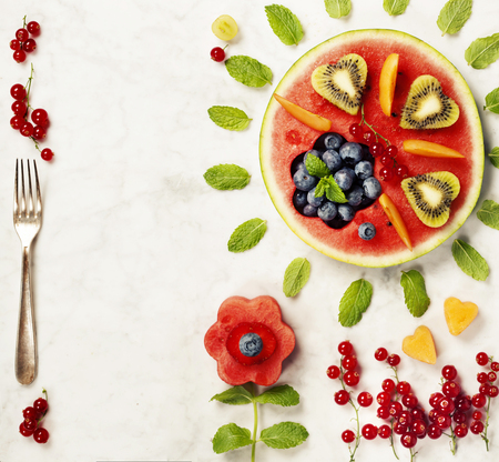 summer fruits: Summer fruit concept. Watermelon, fruits, berries and mint leaves on white marble background. Healthy food concept