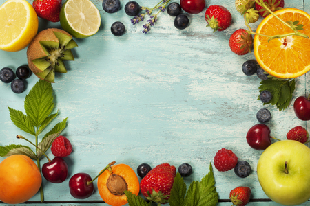summer fruits: Mix of fresh berries and fruits on blue wooden background - Summer Organic Berry over Wood. Agriculture, Gardening, Harvest Concept