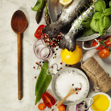 rainbow trout: Raw rainbow trout with vegetables, herbs and spices - Health or Cooking concept
