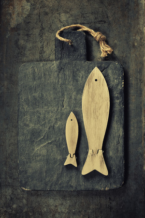 gilt head: Decorative Wooden Fishes on rustic background. Sea food, Health, Cooking concept