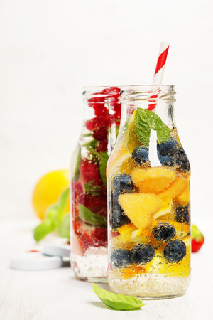 summer fruits: Detox fruit infused flavored water. Refreshing summer homemade cocktail Stock Photo