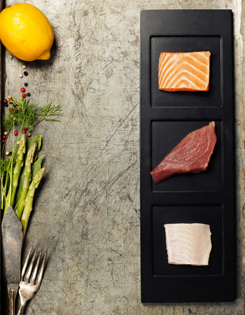 seafish: Assortment of raw fish on rustic background.