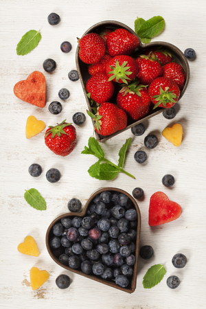 refreshment: Fruits and berries on white marble background. Flat lay