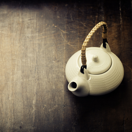 sparce: Image of traditional eastern teapot on rustic background Stock Photo