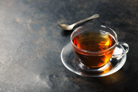 tea table: Cup with black tea on rustic metal background Stock Photo