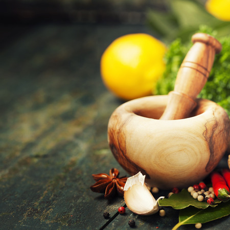 ginseng: Herbs and spices with Mortar and Pestle on wooden background Stock Photo