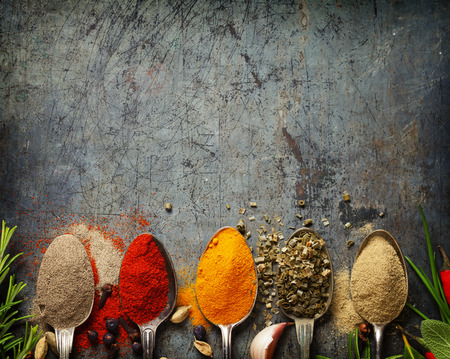 Herbs and spices selection on rustic background - cooking, gardening or vegetarian concept