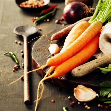 cocina saludable: Vegetables on wood. Bio Healthy food, herbs and spices. Organic vegetables on wood. Cooking concept Foto de archivo