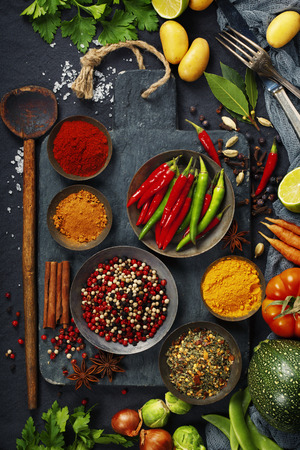 clean food: Fresh delicious ingredients for healthy cooking  on rustic background, top view. Diet, cooking, clean eating or vegetarian food concept. Stock Photo