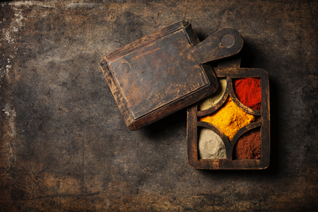 spicy cooking: Spices selection over dark vintage table. Food or spicy cooking concept, Healthy eating Background.