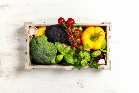 Healthy natural food on rustic wooden table with copy space.